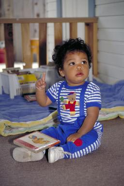 multi-ethnic, toddler, daycare, book, boy, education, Oakland, California
