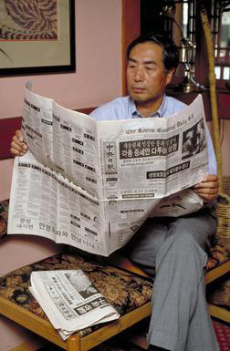 Korean American, newspaper, Oakland, California, reading, 0_ NEW IMAGES _0
